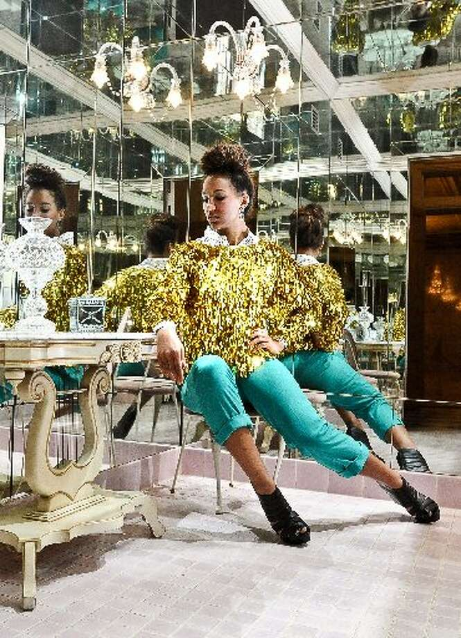 Polka dot button-up, Treasure House, Beaumont, $6.50. Gold spangled sweater, Beaumont estate sale, $15. Trouser pants, Treasure House, $4. Chain link earrings, Treasure House, $2.50. Cost of look (before tax): $28. Styled by Larena Head, modeled by Erikka Walker. Photo by Randy Edwards/cat5