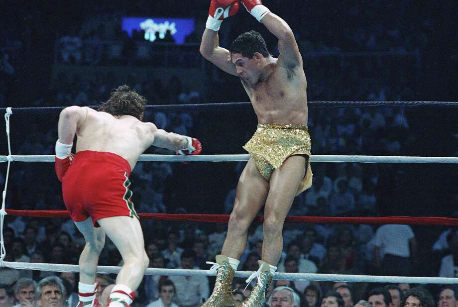 Hector Camacho, right, jumps out of the way of a punch thrown by Ray Mancini during the third round of their WBO Junior Welterweight Title fight in Reno, Nev., March 7, 1989. Camacho won on a split decision. Photo: AP