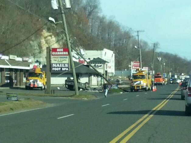Crews work to clear the scene of a single-car crash near Stew Leonardís on Federal Road on Wednesday, Nov. 21, 2012. Photo: Contributed Photo/Alexander Oles