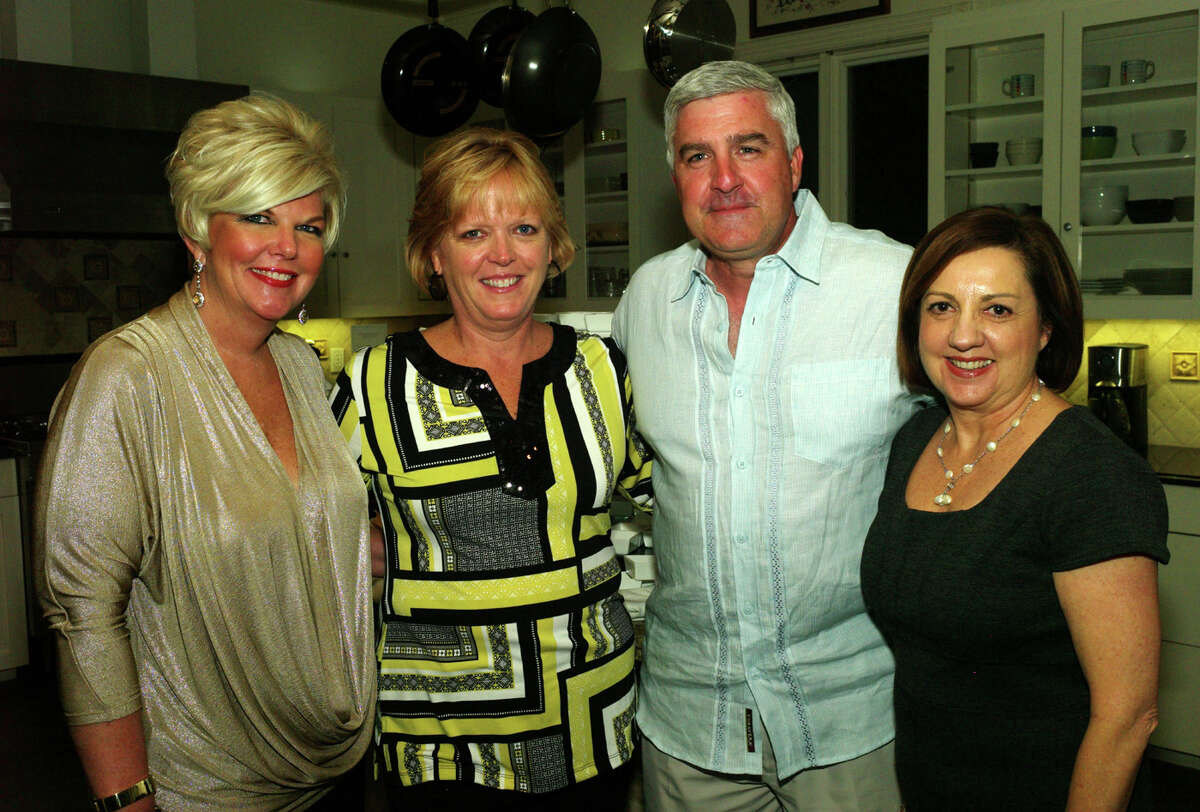 OTS/HEIDBRINK - Chairwoman Kim Gillum, from left, hosts and spouses Sandy Morander, Ron Morander and co hostess Vicki Perkins gather at the Children's Book & Author reception on 11/9/2012. This is #1 of 3 photos. names checked photo by leland a. outz