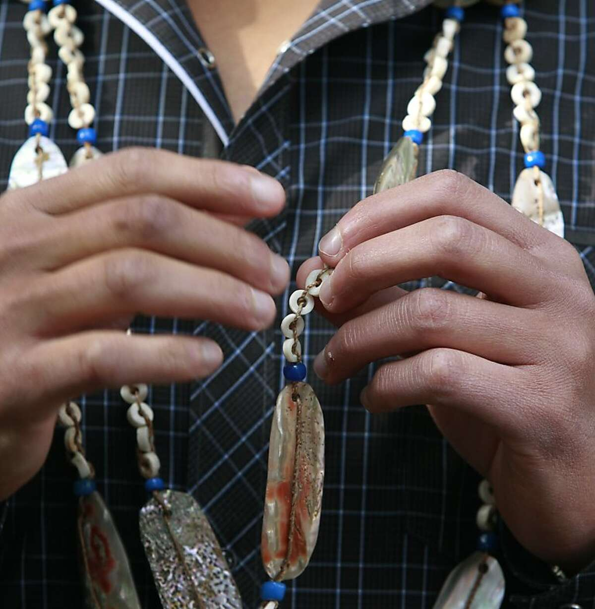 Vincent Medina wears a traditional necklace, handed down from Ohlone ancestors, while leading a tour of Mission Dolores for students from Oakland's Hillcrest Elementary School in San Francisco, Calif. on Thursday, Nov. 15, 2012. Medina is hoping to revive the Cochoenyo language that was spoken by his Ohlone ancestors.