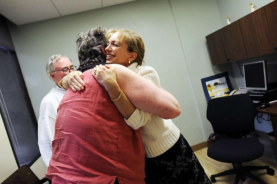 Joan O'Connor gets support from Dr. Catherine Madison (right). Photo: Michael Short, Special To The Chronicle