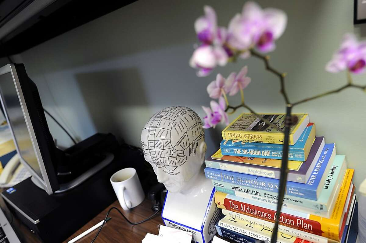 A Phrenology head map is seen next to a stack of books relating to brain health and issues. The new Brain Health Center at CPMC's Davies campus, was made possible by a $21 million anonymous gift, offers treatment and care for people with Alzheimer's and other forms of dementia. San Francisco, CA, Thursday November 15th, 2012.