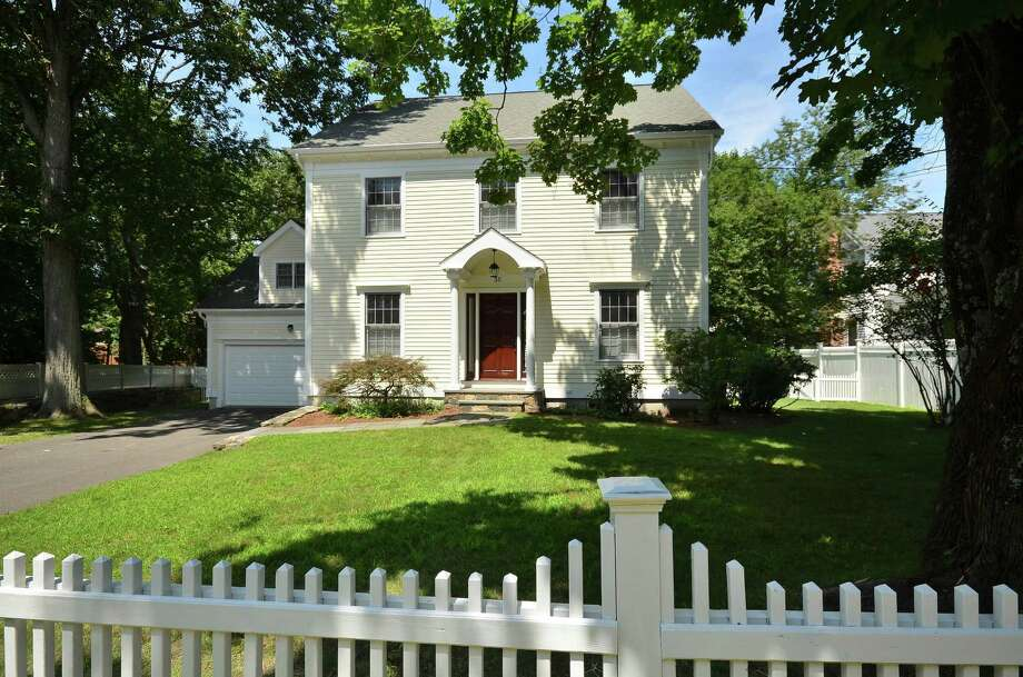This classic Colonial on almost a half acre at 35 Old Road, rebuilt in 1999 and recently renovated, is close to Post Road East and its stores, gas stations and grocery market. It is also close to the I-95 entrance in Southport and the Southport and Greens Farms train stations. Photo: Contributed Photo