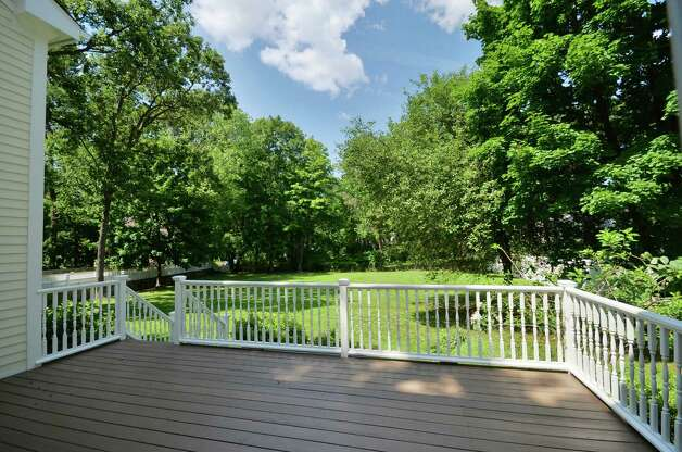 The large wood deck in the backyard may be accessed easily from the kitchen through sliding doors. Photo: Contributed Photo