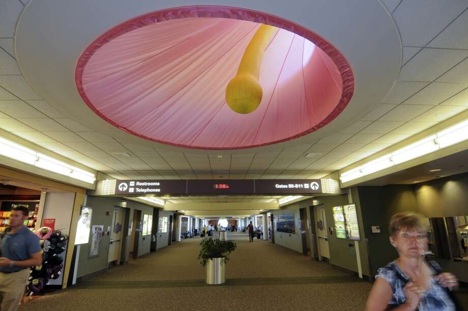 "Artist Sanford Mirling's ""Bellflower,"" installed in the ceiling of  the Albany International Airport's passenger terminal on Wednesday June 20, 2012 in Colonie, NY. (Philip Kamrass / Times Union) (Albany Times Union)"