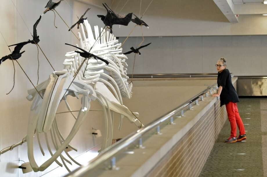 "Albany International Airport Art & Culture Program Director Sharon Bates stands near artist Colin Boyd's ""Cormorant and the Whale,"" at the airport's passenger terminal  on Wednesday June 20, 2012 in Colonie, NY. (Philip Kamrass / Times Union) (Albany Times Union)"