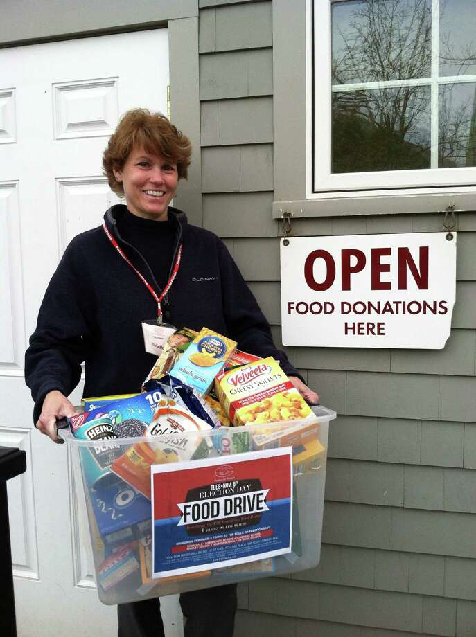 Darien resident and volunteer Michelle Young-Hutchinson participated in Person-to-Personís Election Day Food Drive which collected 200 bags of groceries. Photo: Contributed Photo