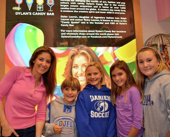 From left, Dylan Lauren, owner of Dylan's Candy Bar, Alexander Domittner, 8, Charlotte Domittner, 10, Skylar Ford, 10, and Elizabeth Domittner, 13, during Lauren's book signing at the Darien Sport Shop Tuesday, Nov. 20, 2012. Photo by Jeanna Petersen Shepard Photo: Freelance Photo
