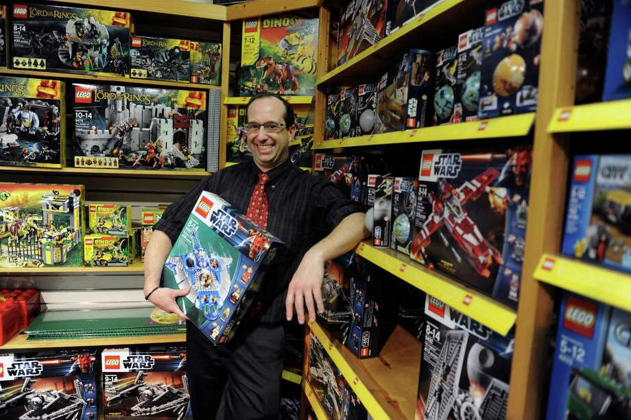 Andrew Lev, manager, of Smart Kids, a toy store holds a Lego's War Wars in Greenwich, Conn., Nov. 21, 2012.  The Smart Kids are celebrating its 25th anniversary this year, and gearing up for holiday shopping. Photo: Helen Neafsey / Greenwich Time