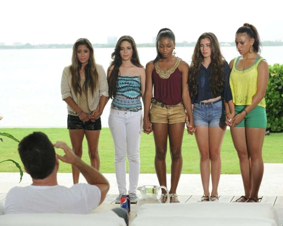 Simon Cowell chooses his final 4 groups to advance to the live shows on THE X FACTOR. Also pictured: Fifth Harmony (formerly 1432 and Lylas) / CR: Ray Mickshaw/ FOX