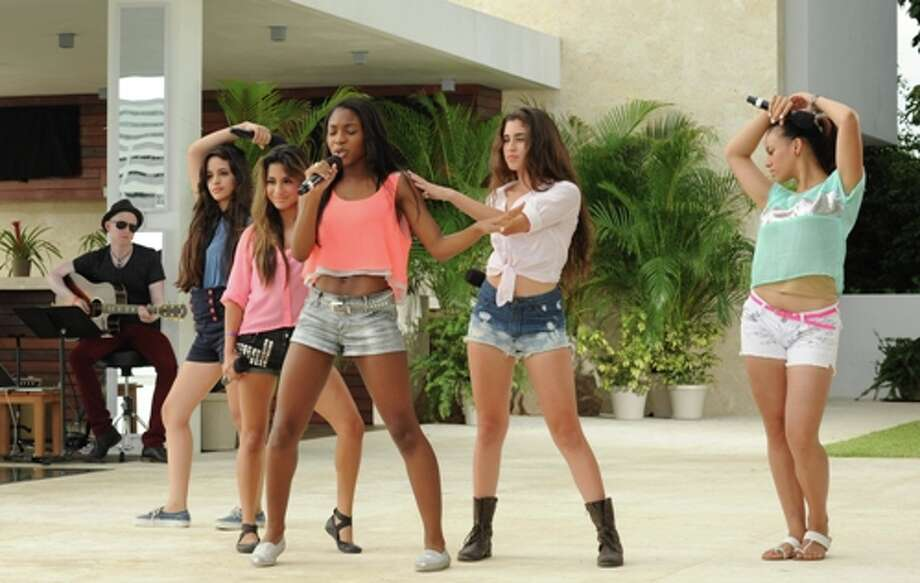 Fifth Harmony (formerly 1432 and Lylas) performs in front of Simon Cowell and guest mentor Marc Anthony on THE X FACTOR airing Wednesday, Oct. 10 (8:00-10:00 PM ET/PT) on FOX. CR: Ray Mickshaw / FOX. (                                                      )