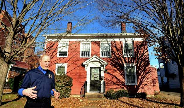 Ken Gucker talks about trying to save a historic house on Main Street, Danbury, built in the early 1800s. The city, which owns the  house, has proposed selling it. Photographed Wednesday, Nov. 21, 2012. Photo: Michael Duffy / The News-Times