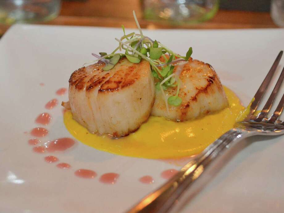 "Bar Sugo Chef/Owner Pat Pascarella says he makes ìfood that Italians eat every day,"" including his take on seared scallops. Photo: Contributed"