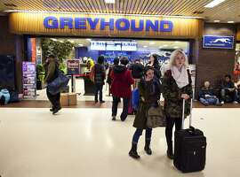 NEW YORK, NY - NOVEMBER 21: People make their way outside of a Greyhound Lines ticket office at the New York Port Authority bus terminal in Manhattan on November 21, 2012 in New York City. The Port Authority of New York and New Jersey is expecting to handle a high number of travelers at its hubs, bridges, and tunnels ahead of the Thanksgiving holiday.  (Photo by Ramin Talaie/Getty Images)