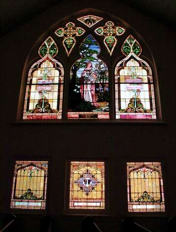 Built in 1911, the sanctuary has three large original Louis Tiffany stained glass windows in it. This is one of them.  Dave Ryan/The Enterprise