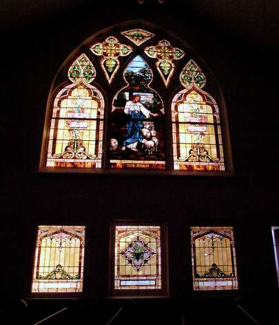 Built in 1911, the sanctuary has three large original Louis Tiffany stained glass windows in it. This is one of them.  Dave Ryan/The Enterprise Photo: Dave Ryan