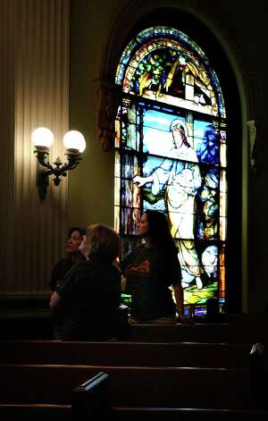 Partitioners of the First Presbyterian Church in Orange gaze upon one of several stained-glass windows on Tuesday, May 29, 2008. Photo by Guiseppe Barranco