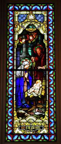 Blessed Sacrament Catholic Church has 12 stained glass windows.       Dave Ryan/The Enterprise