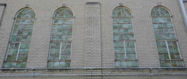 Harvest For Lost Souls Church has these windows in the main sanctuary, but they glow from the inside outward at night.  In the daytime, inside, they reflect the shadows from outside, but on the outside during the day, they look like colored glass.    Dave Ryan/The Enterprise