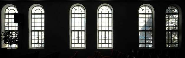Harvest For Lost Souls Church has these windows in the main sanctuary, but they glow from the inside outward at night.  In the daytime, inside, they reflect the shadows from outside.    Dave Ryan/The Enterprise
