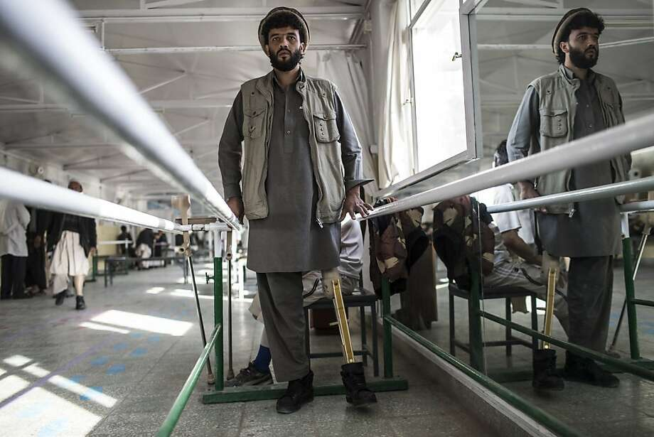 Habibullah, 24, a tailor from Wardak province, lost his leg when he drove over an IED a year ago, practices walking on his new artificial limb on his third day at the International Committee of the Red Cross (ICRC), orthopedic center on November 20, 2012 in Kabul, Afghanistan. Photo: Daniel Berehulak, Getty Images
