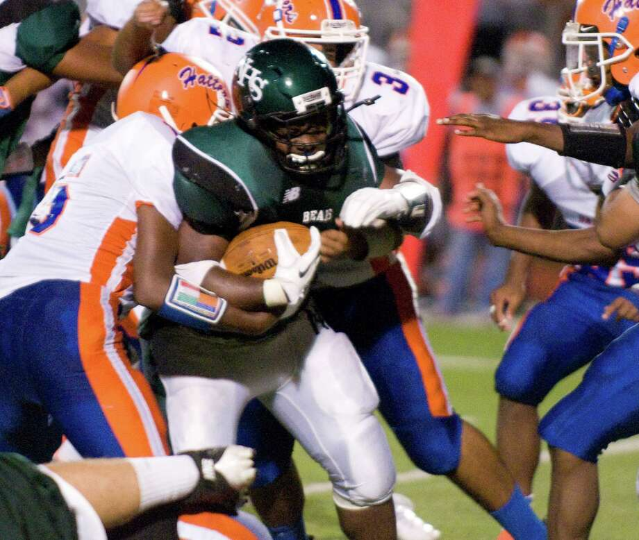 Norwalk's Tomar Joseph pushes through the Danbury defense as Norwalk High School hosts Danbury in a football game Friday, Sept. 14, 2012. Photo: Keelin Daly / Stamford Advocate Freelance