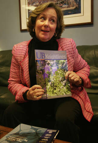 Mary-Jane Foster, vice president of the University of Bridgeport, shows off the school's alumni magazine in her office at Cortright Hall on the university campus in Bridgeport on Tuesday, November 20, 2012. Photo: Brian A. Pounds / Connecticut Post