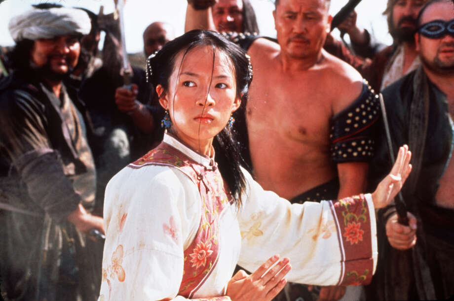 FILE--Zhang Ziyi appears in a scene from the film 'Crouching Tiger, Hidden Dragon' in this undated handout photo. The Mandarin-language martial arts epic, garnered 10 Oscar nominations Tuesday, Feb. 13, 2001, in Los Angeles, including best picture and best director. (AP Photo/Sony Pictures Classics, Chan Kam Chuen) Photo: CHAN KAM CHUEN