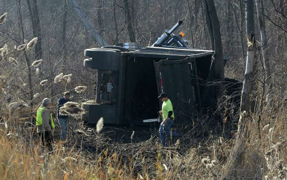 A tractor trailer sits that was carrying mulch sits on its side just south of Exit 10 of I-87 near Round Lake, N.Y Nov 21, 2012.    (Skip Dickstein/Times Union) Photo: SKIP DICKSTEIN / 00020167A