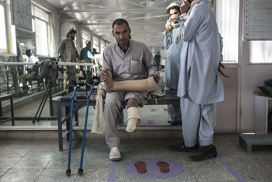 An Aghan man sits holding his prosthetic limb as he waits for a fitting with a specialist at the International Committee of the Red Cross (ICRC) orthopedic center  on November 20, 2012 in Kabul, Afghanistan. The ICRC rehabilitation center works to educate and rehabilitate land-mine victims,  and those with limb related deformities, back into society and employment offering micro-credit financing, home schooling and vocational training to patients. The clinic itself is unique in that all of the workers are handicapped. The ICRC center in Kabul has registered over 57,000 patients and 114,000 countrywide in all of their centers since its inception 25 years ago. Photo: Daniel Berehulak, Getty Images