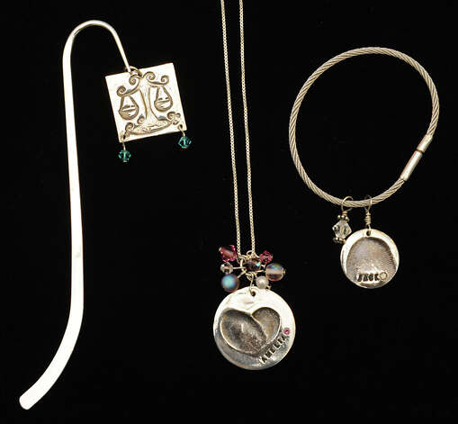 The silver clay bookmark, $67, keychain, $72.50 and necklace, $98.5, at the Pottery Place in Stuyvesant Plaza on Tuesday, Nov. 13, 2012 in Albany, N.Y.  (Lori Van Buren / Times Union) Photo: Lori Van Buren