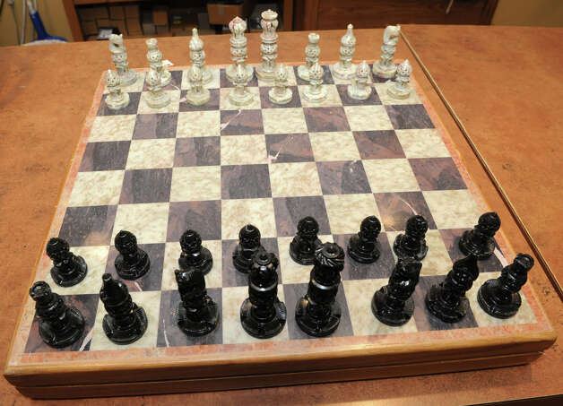 A hand carved, 14-square inch, wood and soapstone chess set, $130, made by Tara Projects from India at 10,000 Villages in Stuyvesant Plaza on Tuesday, Nov. 13, 2012 in Albany, N.Y.  (Lori Van Buren / Times Union) Photo: Lori Van Buren
