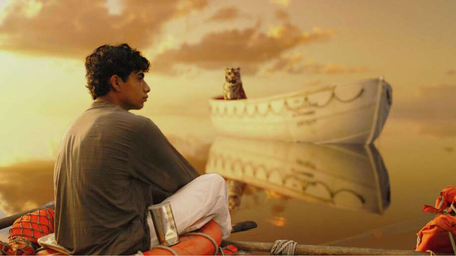 Twentieth Century Fox Pi (Suraj Sharma) and a Bengal tiger known as Richard Parker arrive at an uneasy detente in director Ang Lee?s LIFE OF PI. TM and c. 2011 Twentieth Century Fox Film Corporation.  All rights reserved. Photo: Jason / TM and © 2011 Twentieth Century Fox Film Corporation.  All rights reserved.  Not for sale or duplication.