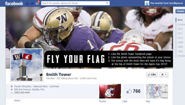 The crimson Washington State flag will fly atop Seattle's historic Smith Tower Friday after Cougar fans won a Facebook contest between Huskies and WSU fans. Photo: Smith Tower Facebook Page