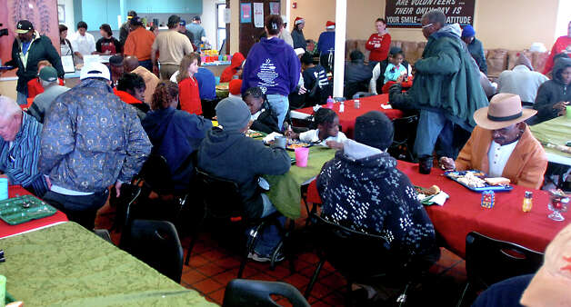 Hundreds of people arrive for a free Christmas dinner at the Catholic Charities of Southeast Texas Hospitality Center in Port Arthur, Saturday, December 24,  2011. Tammy McKinley/The Enterprise Photo: TAMMY MCKINLEY