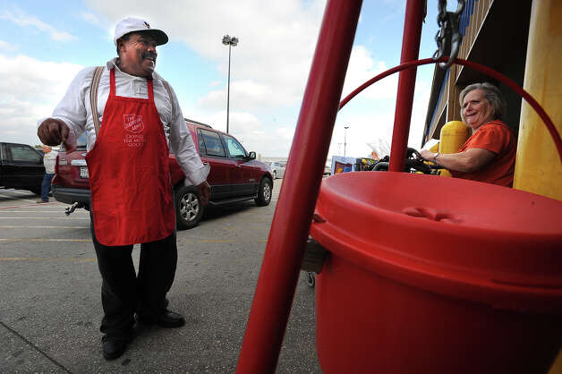 In the process of retiring, Raphael Collins volunteers to ring the Salvation Army's bell this holiday to give back to his community. Monday was Collin's third day to volunteer. Guiseppe Barranco/The Enterprise Photo: Guiseppe Barranco / Beaumont
