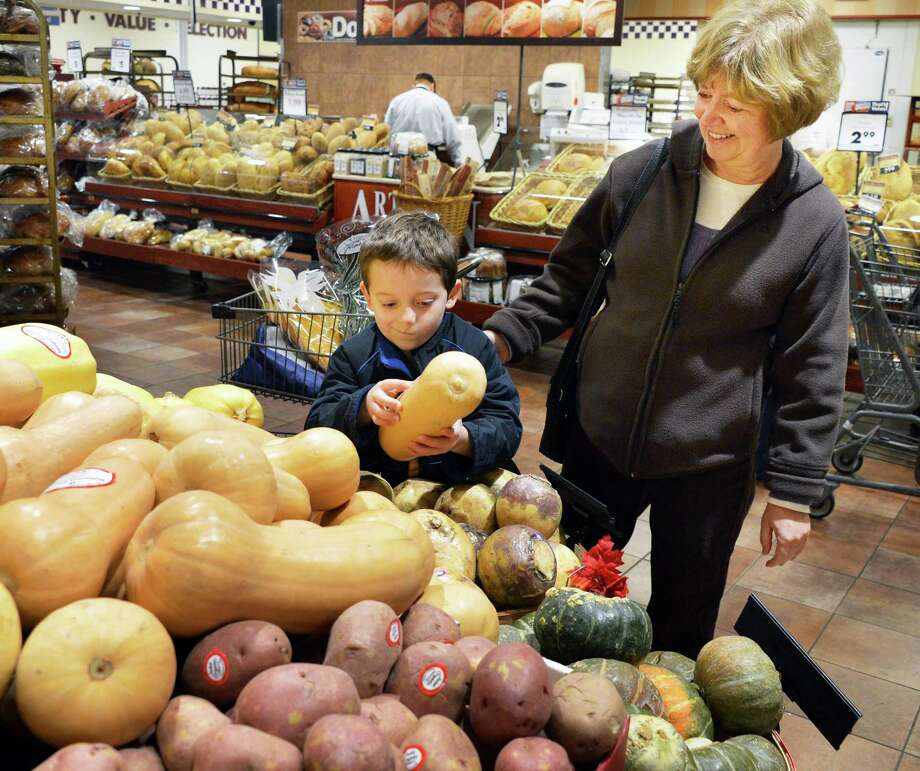 Six-year-old Alex Warner of Scotia helps his grandmother  Donna Meixner of Delmar pick out squash for Thanksgiving dinner at Price Chopper in Slingerlands Wednesday Nov. 21, 2012.  (John Carl D'Annibale / Times Union) Photo: John Carl D'Annibale / 00020201A