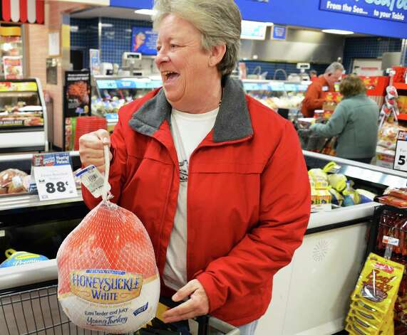 Cindy Bevington of East Berne picks out a turkey for Thanksgiving dinner at Price Chopper in Slingerlands Wednesday Nov. 21, 2012.  (John Carl D'Annibale / Times Union) Photo: John Carl D'Annibale / 00020201A
