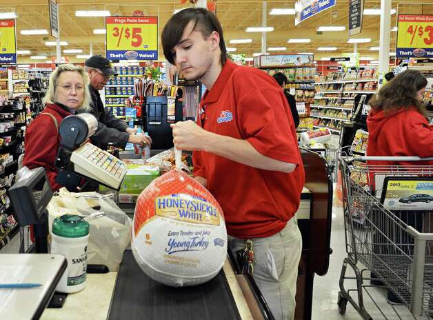Cashier John DeLong of Westerlo rings up groceries for Thanksgiving dinners at Price Chopper in Slingerlands Wednesday Nov. 21, 2012.  (John Carl D'Annibale / Times Union) Photo: John Carl D'Annibale / 00020201A