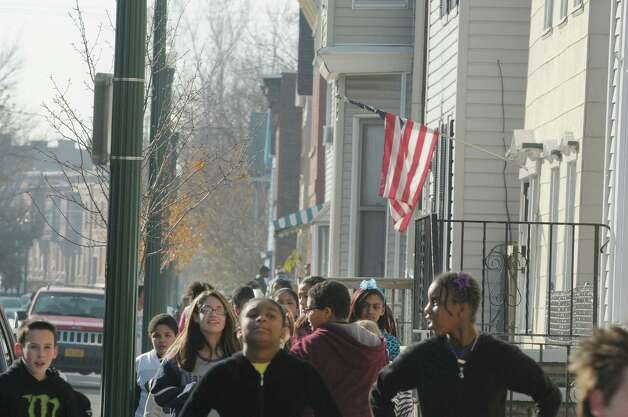 Students make their way along 2nd St. as seventh and eighth graders at Doyle Middle School took part in the Doyle Dash, a 3/4 of a mile run/walk on the streets near the school  The students spent the first part of the morning in their classrooms talking about anti-bullying and acceptance of others before heading out in groups to take part in the Doyle Dash.  School officials said they plan to make the event a yearly tradition on the day before Thanksgiving Day break.  School plans for next year have the students back in the location near the high school where the building is being renovated.   (Paul Buckowski / Times Union) Photo: Paul Buckowski