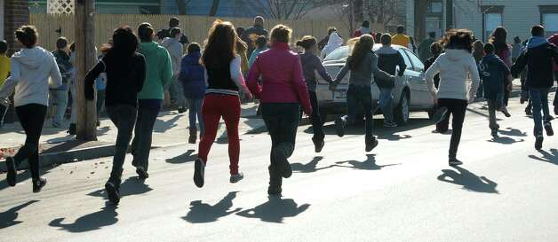 Students run down 1st Street  as seventh and eighth graders at Doyle Middle School took part in the Doyle Dash, a 3/4 of a mile run/walk on the streets near the school    (Paul Buckowski / Times Union) Photo: Paul Buckowski