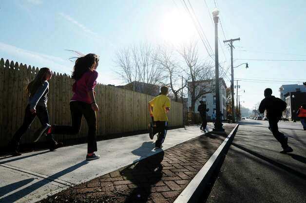 Students run down 1st Street in Troy, N.Y., as seventh and eighth graders at Doyle Middle School took part in the Doyle Dash, a 3/4 of a mile run/walk on the streets near the school. (Paul Buckowski / Times Union) Photo: Paul Buckowski