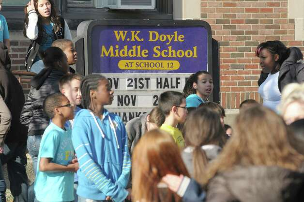 Students catch their breath outside Doyle Middle School after taking part in the Doyle Dash, a 3/4 of a mile run/walk on the streets near the school  The students spent the first part of the morning in their classrooms talking about anti-bullying and acceptance of others before heading out in groups to take part in the Doyle Dash.   (Paul Buckowski / Times Union) Photo: Paul Buckowski
