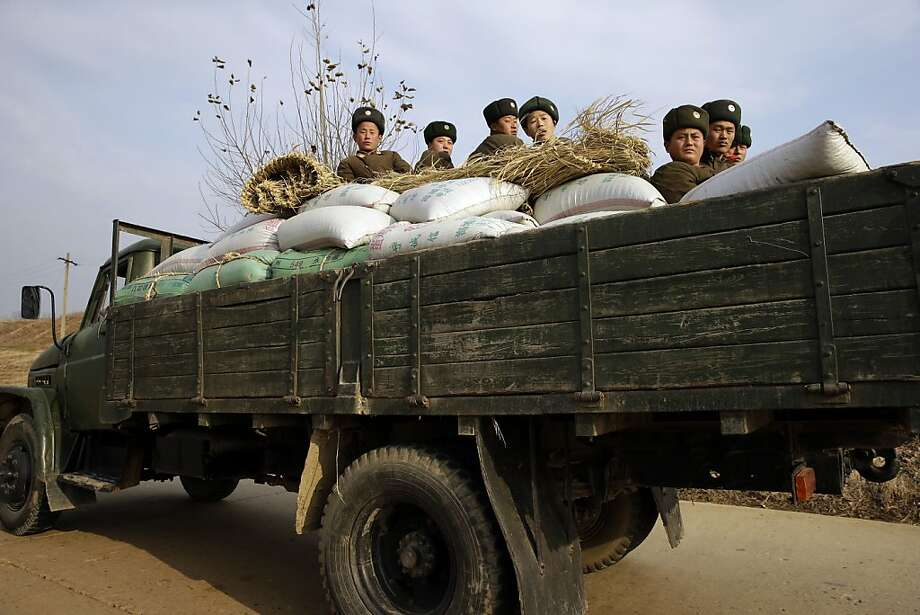 The 'Red Dawn' enemy:A North Korean army transport loads up near the town of Sinchon in South Hwanghae province. Just find yourselves a comfortable seat between the rice bags, fellas. Photo: Ng Han Guan, Associated Press