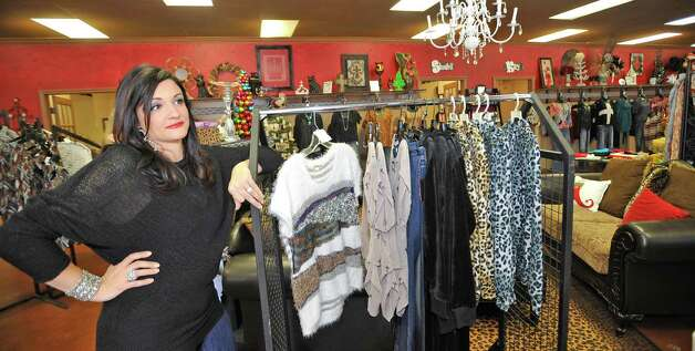 "April LeBlanc, left, who is the owner of Serenity Boutique and Salon in Silsbee, brings out more merchandise to hang on the racks for tomorrow's sale. LeBlanc will be opening her doors on Thanksgiving Day at 6 p.m. for early retail shoppers. She will be competing with ""big box"" retailers despite her starting the fad in 2010 when she first opened her doors as a new business. She is afraid that the new ""big"" store trend could hurt her by opening their doors on Thanksgiving, a holiday reserved for family, as well.   Dave Ryan/The Enterprise"