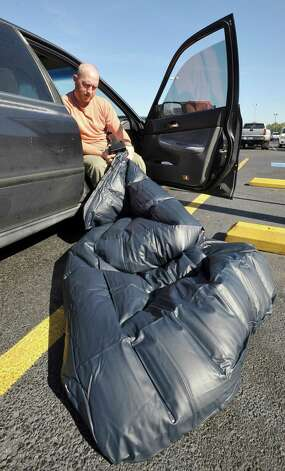 Seasoned Black Friday shoppers like Jared Gilthorpe, seen here inflating another air mattress for his tent, and friend Marcus Paterno, are already lined up outside of Best Buy, hoping to scoop up deals on electronics. They are the first in line at the Best Buy in Beaumont.    Dave Ryan/The Enterprise Photo: Dave Ryan
