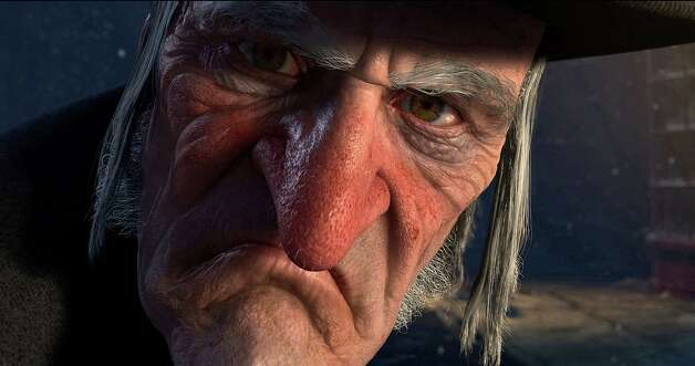 "In this film publicity image released by Disney, Ebenezer Scrooge, voiced by Jim Carrey, is shown in a scene from ""A Christmas Carol.""  (AP Photo/Disney, ImageMovers Digital LLC) Photo: ImageMovers Digital LLC., HO / Beaumont"