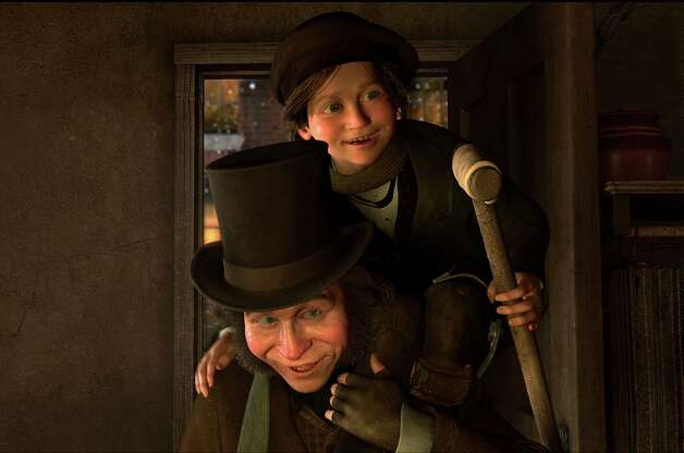 "In this film publicity image released by Disney, Bob Cratchit carries Tiny Tim, both characters voiced by Gary Oldman, in a scene from ""A Christmas Carol.""  (AP Photo/Disney, ImageMovers Digital LLC) Photo: ImageMovers Digital LLC., HO / Beaumont"