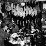 A city bar in London at Christmas with plucked turkeys hanging overhead on Dec. 1, 1923.